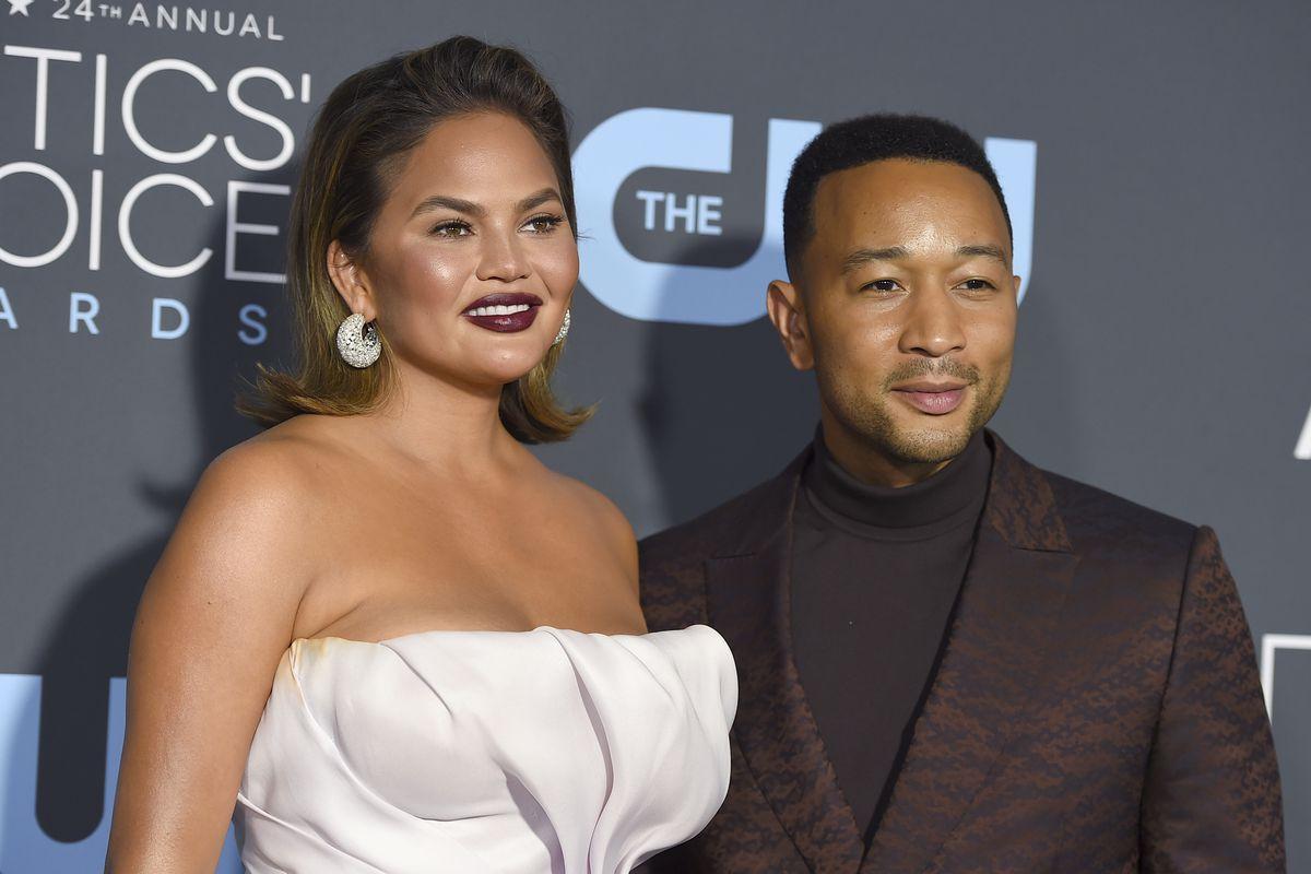 Chrissy Teigen and John Legend arrive at the 24th annual Critics' Choice Awards in 2019, in Santa Monica, California.