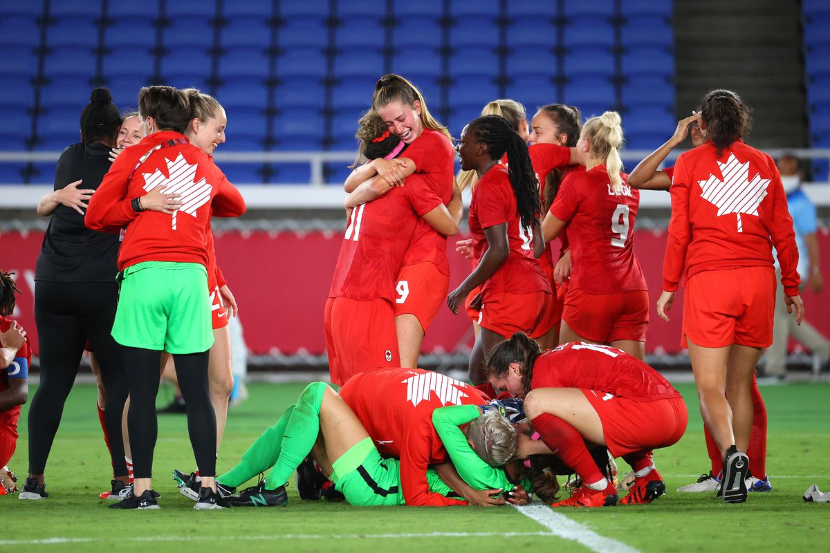 Team Canada celebrates after defeating Team Sweden in a penalty shoot-out to win gold in the women's football gold medal match between Canada and Sweden on day fourteen of the Tokyo 2020 Olympic Games at International Stadium Yokohama on August 06, 2021 in Yokohama, Kanagawa, Japan.