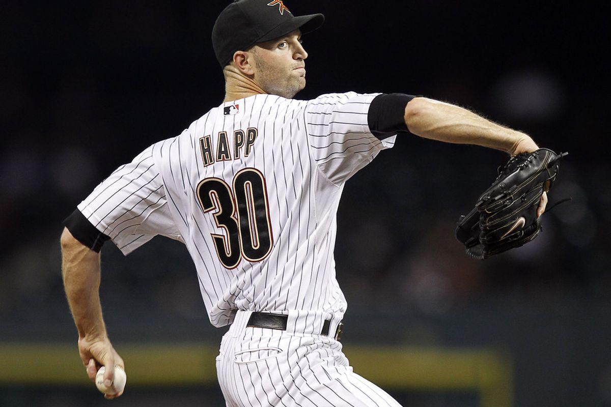 HOUSTON - SEPTEMBER 13:  Pitcher J.A. Happ #30 throws in the sixth inning against the Philadelphia Phillies at Minute Maid Park on September 13, 2011 in Houston, Texas.  (Photo by Bob Levey/Getty Images)