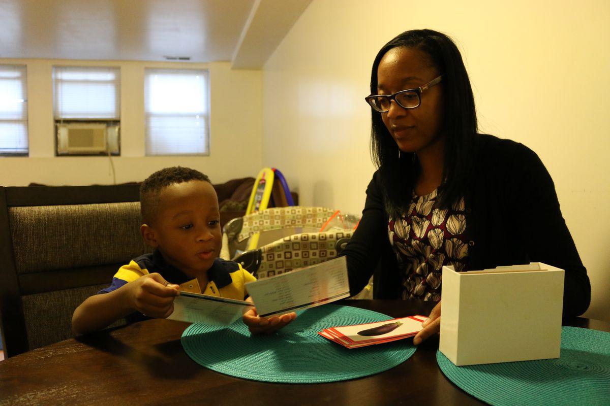 Shavon Gilliam runs through flashcards with her son, Mikel.