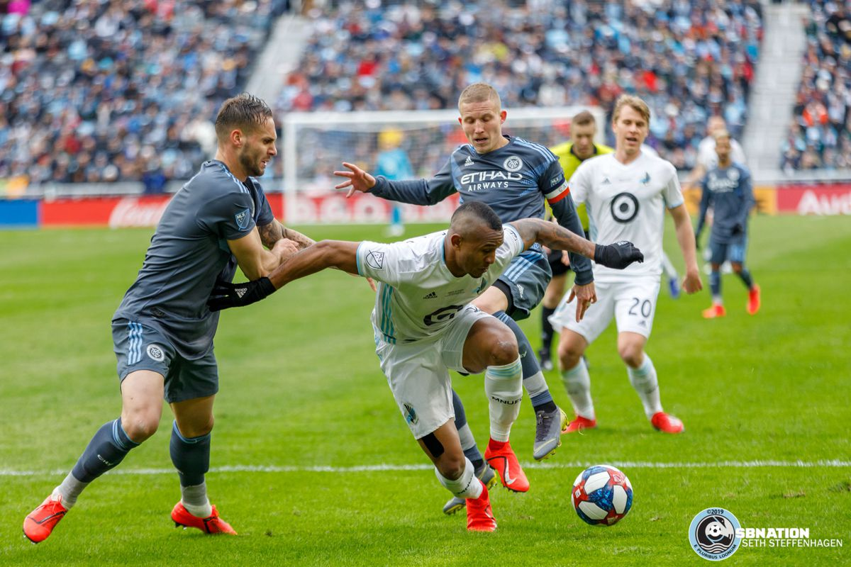 April 13, 2019 - Saint Paul, Minnesota, United States - Minnesota United forward Angelo Rodriguez (9) holds off New York City FC defender Maxime Chanot (4) and New York City FC midfielder Alexander Ring (8) during the Loon's inaugural match at Allianz Field.   (Photo by Seth Steffenhagen/Steffenhagen Photography)