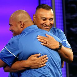 'Ilaisa Tuiaki, defensive coordinator and defensive line coach, and Kalani Sitake, head coach, embrace during BYU Football Media Day at BYU Broadcasting in Provo on Friday, June 23, 2017.