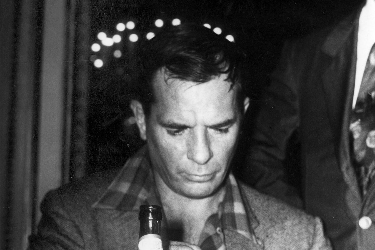 Jack Kerouac Sitting At A Small Table