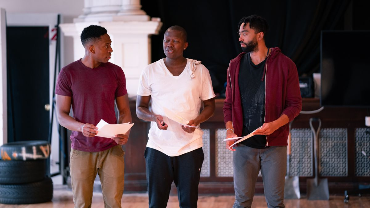 """Patrick Agada (as Oshoosi Size, from left), Manny Buckley (as Ogun Size) and Rashaad Hall (as Elegba) in Steppenwolf for Young Adults' rehearsal for """"The Brothers Size."""""""