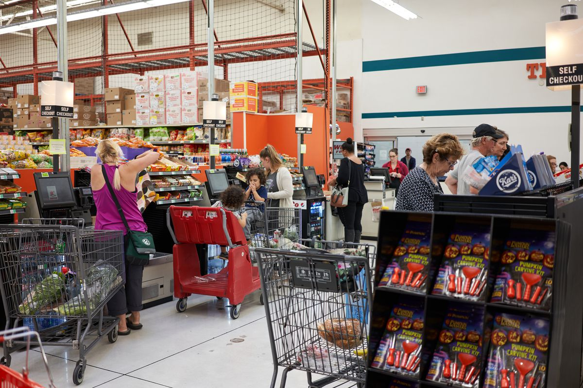 The self-checkout and checkout lines at Winco, where guests line up with shopping carts
