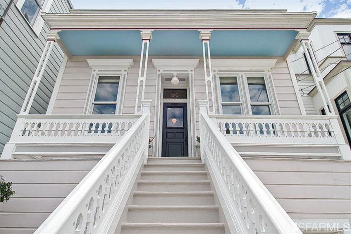 Exterior of Bernal Heights Victorian with porch and large staircase leading to the front door.