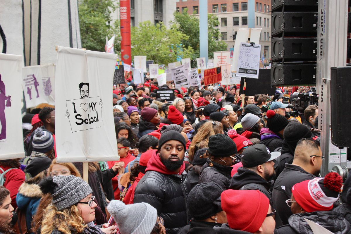 Teachers gather outside of the Thompson Center in downtown Chicago on the fifth day of a strike in October 2019.