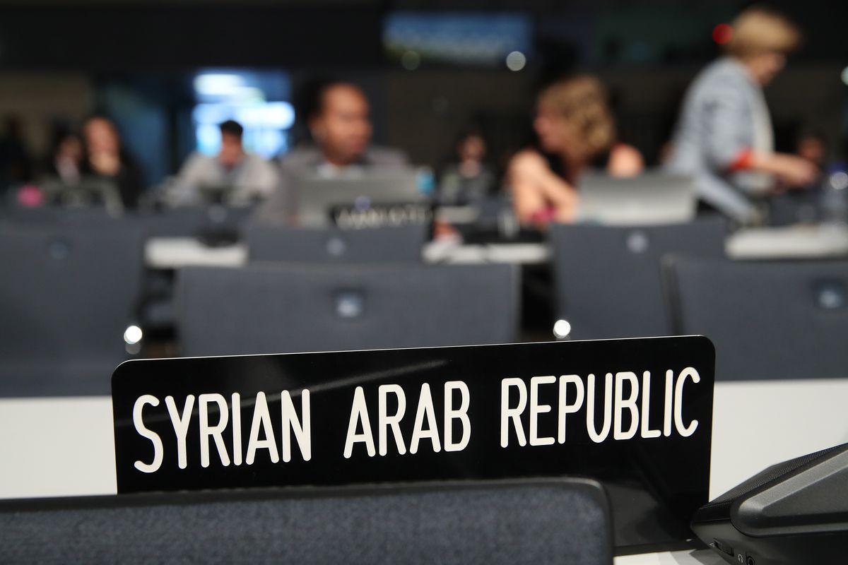 Syria just agreed to sign the paris climate agreement making the a sign marks the desk of the syrian delegation prior to an afternoon plenary session at the cop 23 united nations climate change conference on november 7 platinumwayz