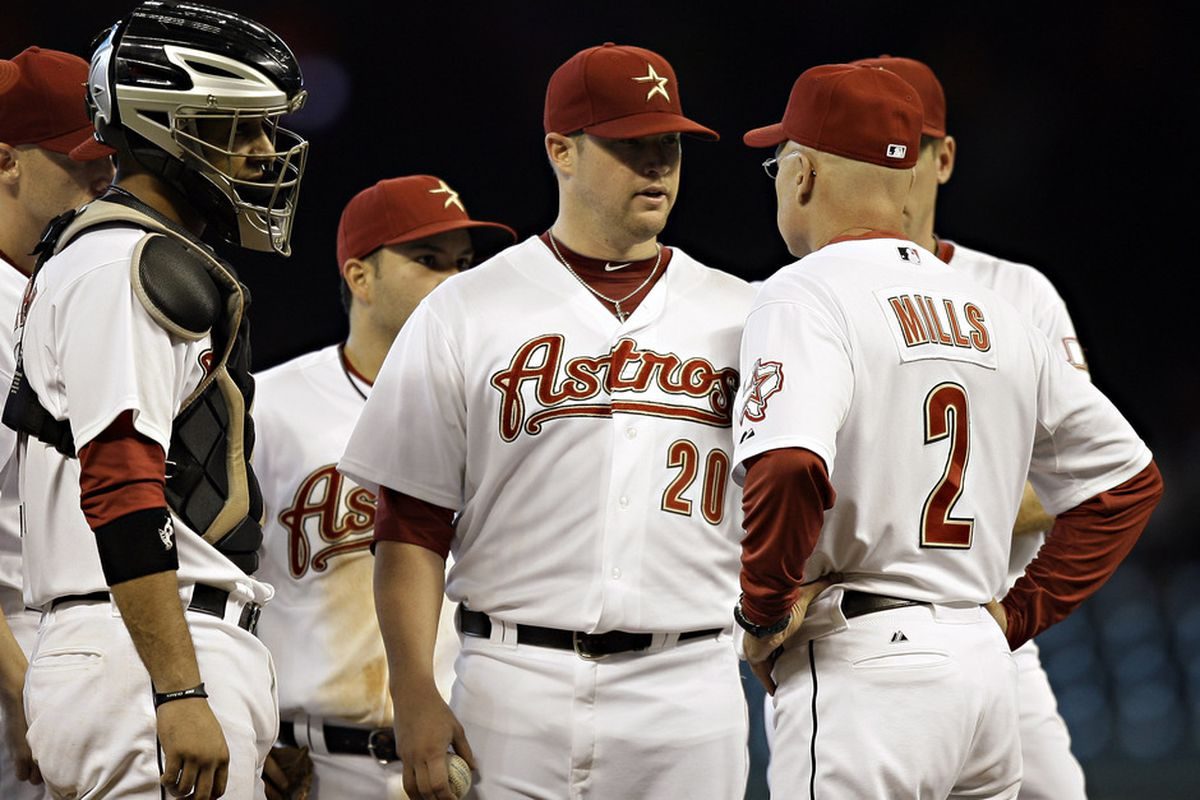 HOUSTON - AUGUST 17:  Pitchere Bud Norris #20 of the Houston Astros talks with manager Brad Mills #2 at Minute Maid Park on August 17, 2011 in Houston, Texas.  (Photo by Bob Levey/Getty Images)
