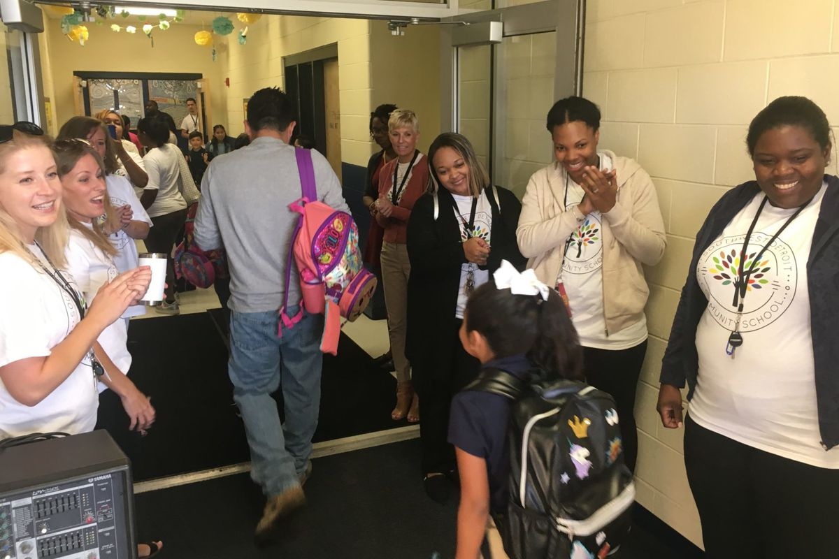 Teachers welcome students to the Southwest Detroit Community School on the first day of school. Seven of the charter's 31 educators last year entered the profession through a fast-track training program.