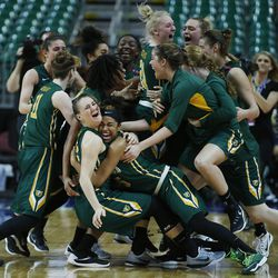 The San Francisco Lady Dons celebrate the win over Brigham Young Cougars during the WCC tournament championship in Las Vegas Tuesday, March 8, 2016. San Francisco won 70-68.