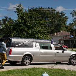 The hearse carrying DaJore Wilson's body exits the driveway of Abundant Living Christian Center in Dolton, Friday morning, Sept. 18, 2020. Wilson was fatally shot in Canaryville Sept. 7.