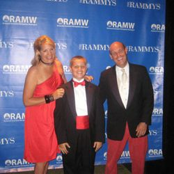 Ellen Kassoff Gray, son Harrison and chef of the year winner Todd Gray, all in matching outfits.