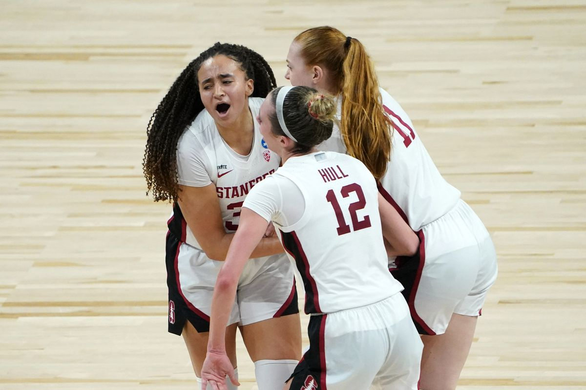 Stanford Cardinal guards Haley Jones and Lexie Hull celebrate with forward Ashten Prechtel during the second half against the Louisville Cardinals at Alamodome.