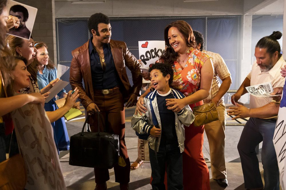 """This image released by NBC shows Joseph Lee Anderson as Rocky Johnson (from left), Adrian Groulx as Dwayne and Stacey Leilua as Ata Johnson in a scene from """"Young Rock."""""""