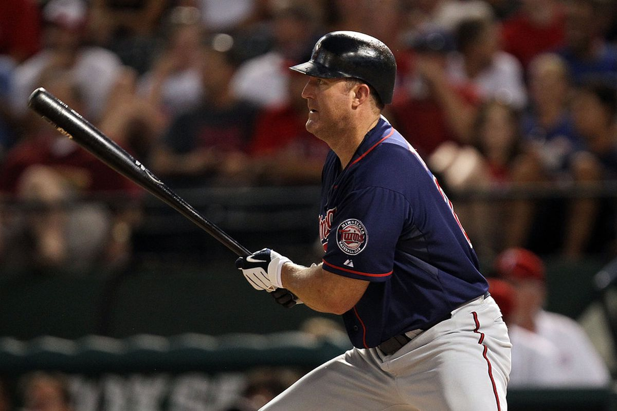 ARLINGTON, TX - JULY 28:  Jim Thome #25 of the Minnesota Twins hits a RBI single against the Texas Rangers at Rangers Ballpark in Arlington on July 28, 2011 in Arlington, Texas.  (Photo by Ronald Martinez/Getty Images)