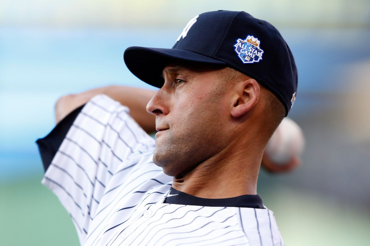 KANSAS CITY, MO - JULY 10:  American League All-Star Derek Jeter #2 of the New York Yankees throws the ball before the 83rd MLB All-Star Game at Kauffman Stadium on July 10, 2012 in Kansas City, Missouri.  (Photo by Jamie Squire/Getty Images)