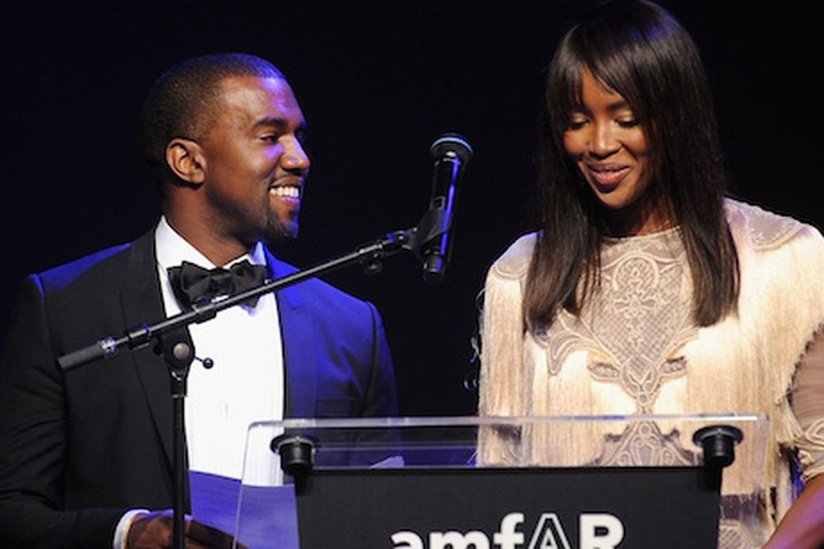 Kanye West and Naomi Campbell at the amfAR benefit (Photo: Getty Images)
