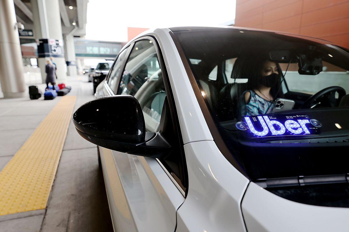 Uber driver Teresea Melendez waits for her passenger at the Salt Lake City International Airport.