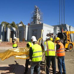 The Angel Moroni statue is prepared to be lifted to the top of the Cordoba Argentina Temple.
