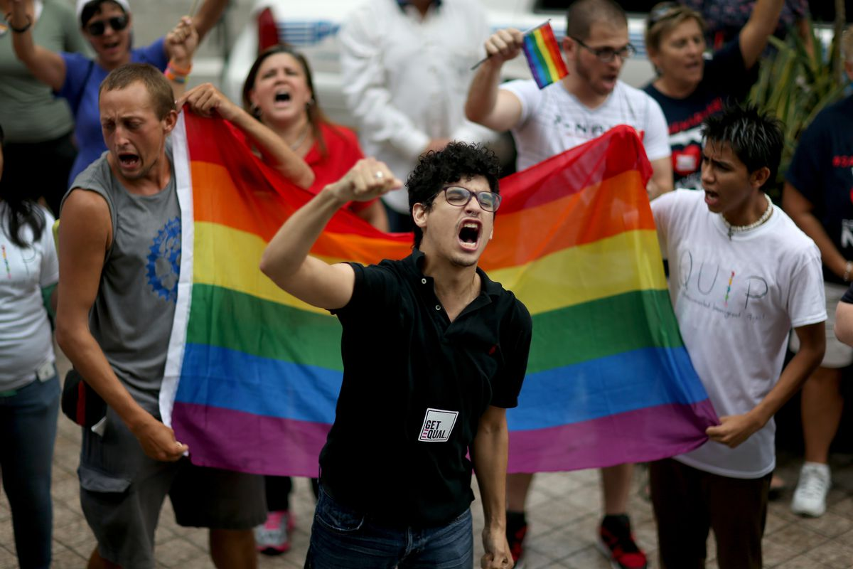 Gabriel Garcia-Vera joins with others to show support for LGBTQ couples in Miami, Florida.