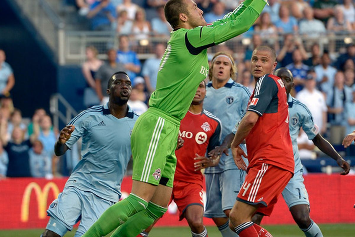 KANSAS CITY, KS - JUNE 16:  Goalkeeper Milos Kocic #30 of the Toronto FC makes a save during the MLS game against Sporting KC on June 16, 2012 at Livestrong Sporting Park in Kansas City, Kansas.  (Photo by Jamie Squire/Getty Images)