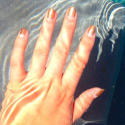 I snap some artsy pics of my glittery nails by the pool. It's way harder than you think to take photographs of your hands!