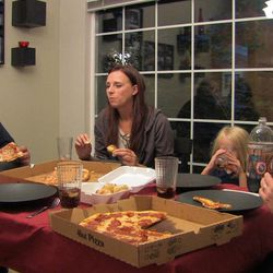 Ruben Israel eats dinner with Bryan, his wife Melanie, son Wiley and daughter Naomi Hall in Bryan Hall's house.