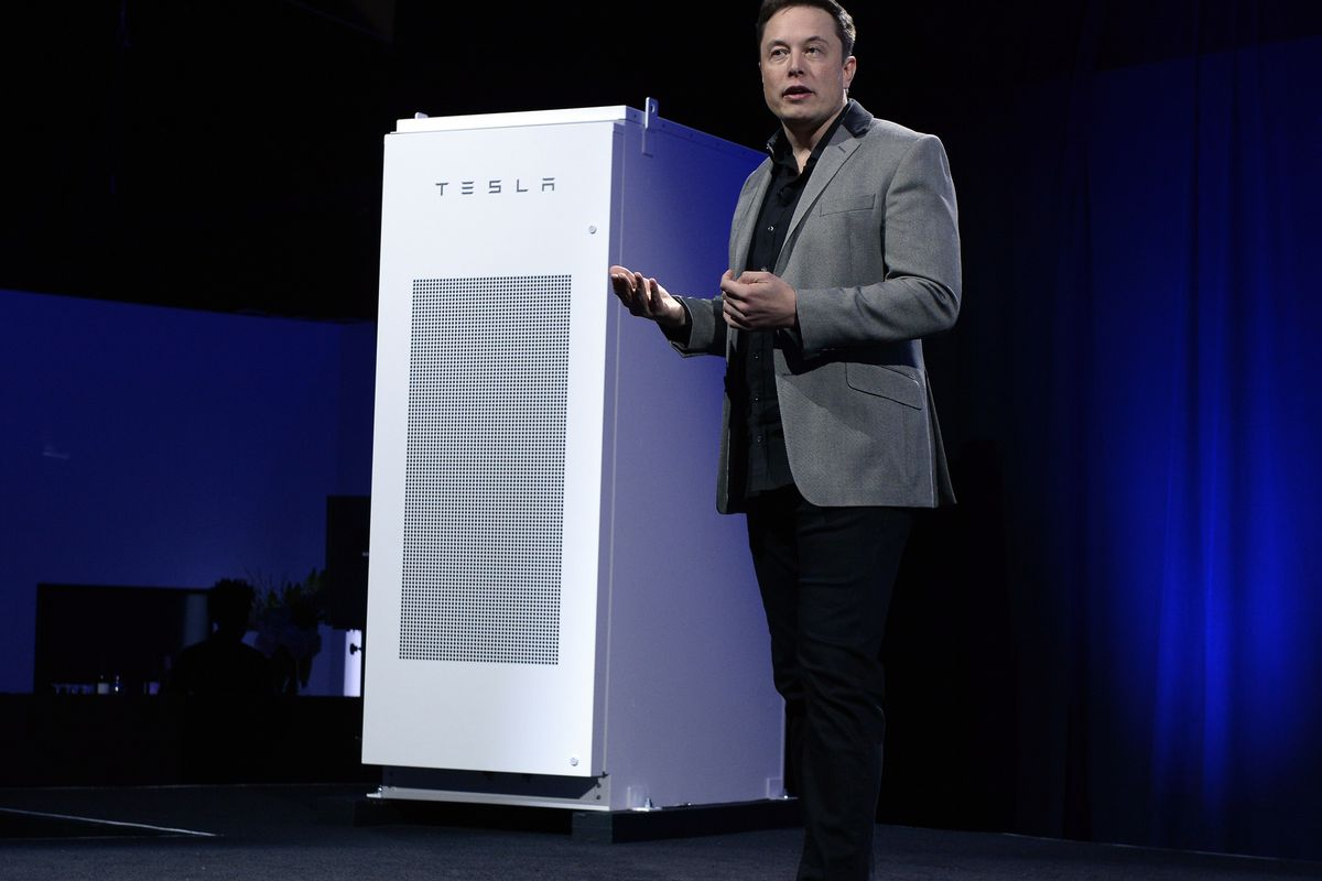 Elon Musk, CEO of Tesla, unveils a suite of batteries for homes, businesses, and utilities at Tesla Design Studio April 30, 2015 in Hawthorne, California.