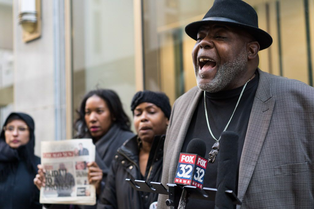 Community organizer Jitu Brown (right) outside CPS headquarters on Feb. 26, 2018, demanding that the Chicago Board of Education cancel a planned vote to close the National Teachers Academy and four Englewood' neighborhood high schools. | Max Herman / Sun-