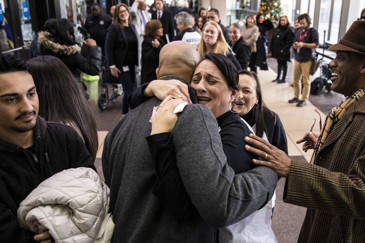 Angelica Nieves hugs attorney Andrew Stroth after a Cook County judge found Chicago Police Officer Lowell Houser guilty of second-degree murder in the 2017 off-duty shooting of her brother Jose Nieves at the Leighton Criminal Courthouse, Friday afternoon,