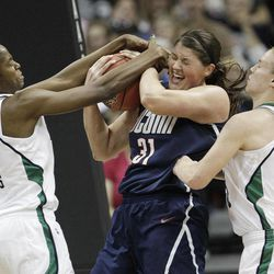Notre Dame forward Devereaux Peters (14) and Notre Dame guard Natalie Novosel (21) vie for a lose ball against  Connecticut center Stefanie Dolson (31)  during the first half of the NCAA women's Final Four semifinal college basketball game, in Denver, Sunday, April 1, 2012.