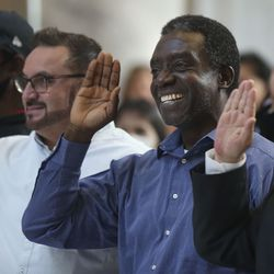 Dr. Michael Kofi Addae-Kagyah, from Ghana, second from right, takes the oath of allegiance to become a U.S. citizen at the Capitol in Salt Lake City on Thursday, Aug. 12, 2021. One hundred twenty-four citizenship candidates from 38 countries became U.S. citizens.
