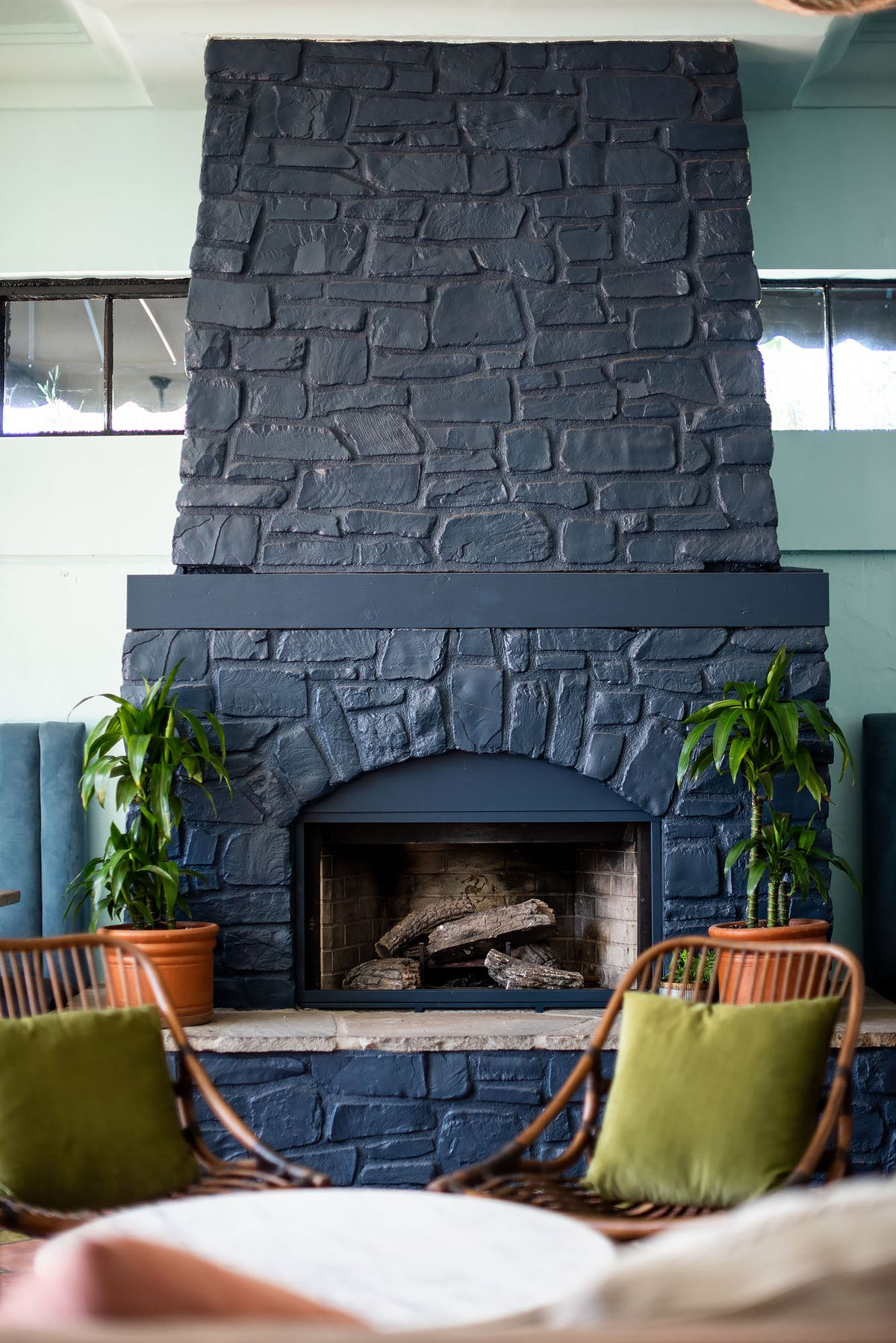 A painted fireplace at a cozy bar.