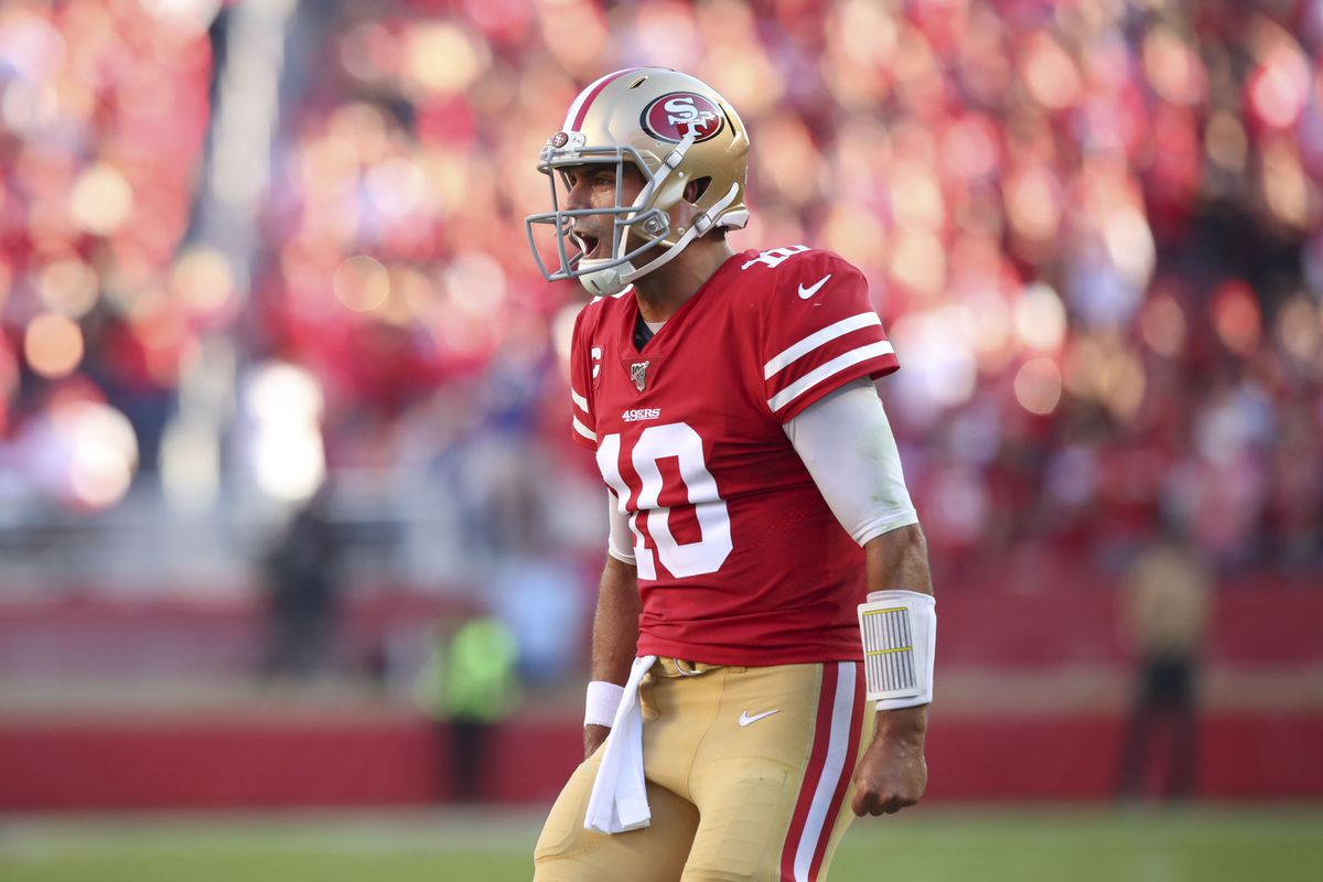 San Francisco 49ers quarterback Jimmy Garoppolo reacts after throwing a touchdown pass against the Arizona Cardinals in the third quarter at Levi's Stadium.
