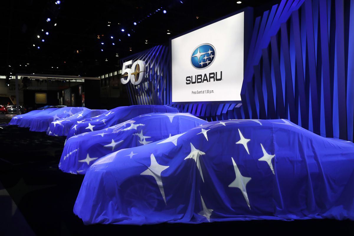 FILE - The Subaru logo is projected on several veiled Subaru vehicles before the 50th Anniversary of Subaru in North America at the Chicago Auto Show, Thursday, Feb. 8, 2018, in Chicago. (AP Photo/Charles Rex Arbogast)