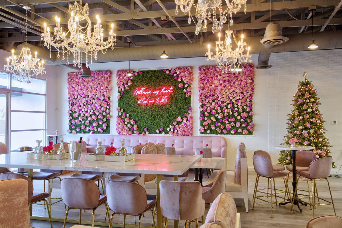 A pink social media wall at Cafe Lola