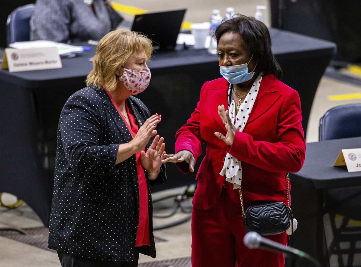 Then state Rep. Terri Bryant, R-Murphysboro, left, talks with state Rep. Mary Flowers, D-Chicago, during a session of the Illinois House of Representatives at the Bank of Springfield Center in 2020.