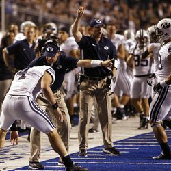 Taysom Hill, back to camera, is told to go back and try a two point conversion after scoring BYU's only touchdown during NCAA football in Boise, Thursday, Sept. 20, 2012.