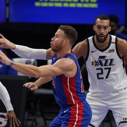 Detroit Pistons forward Blake Griffin passes in front of Utah Jazz center Rudy Gobert (27) during the first half of an NBA basketball game, Sunday, Jan. 10, 2021, in Detroit.
