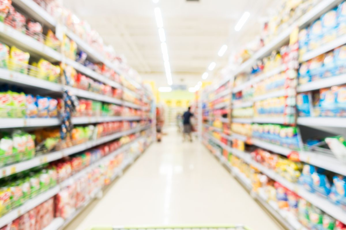Abstract blur supermarket and retail store in shopping mall interior for background