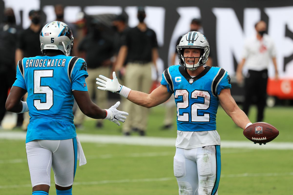 Christian McCaffrey #22 of the Carolina Panthers celebrates with Teddy Bridgewater #5 after scoring a touchdown during the third quarter against the Tampa Bay Buccaneers at Raymond James Stadium on September 20, 2020 in Tampa, Florida.