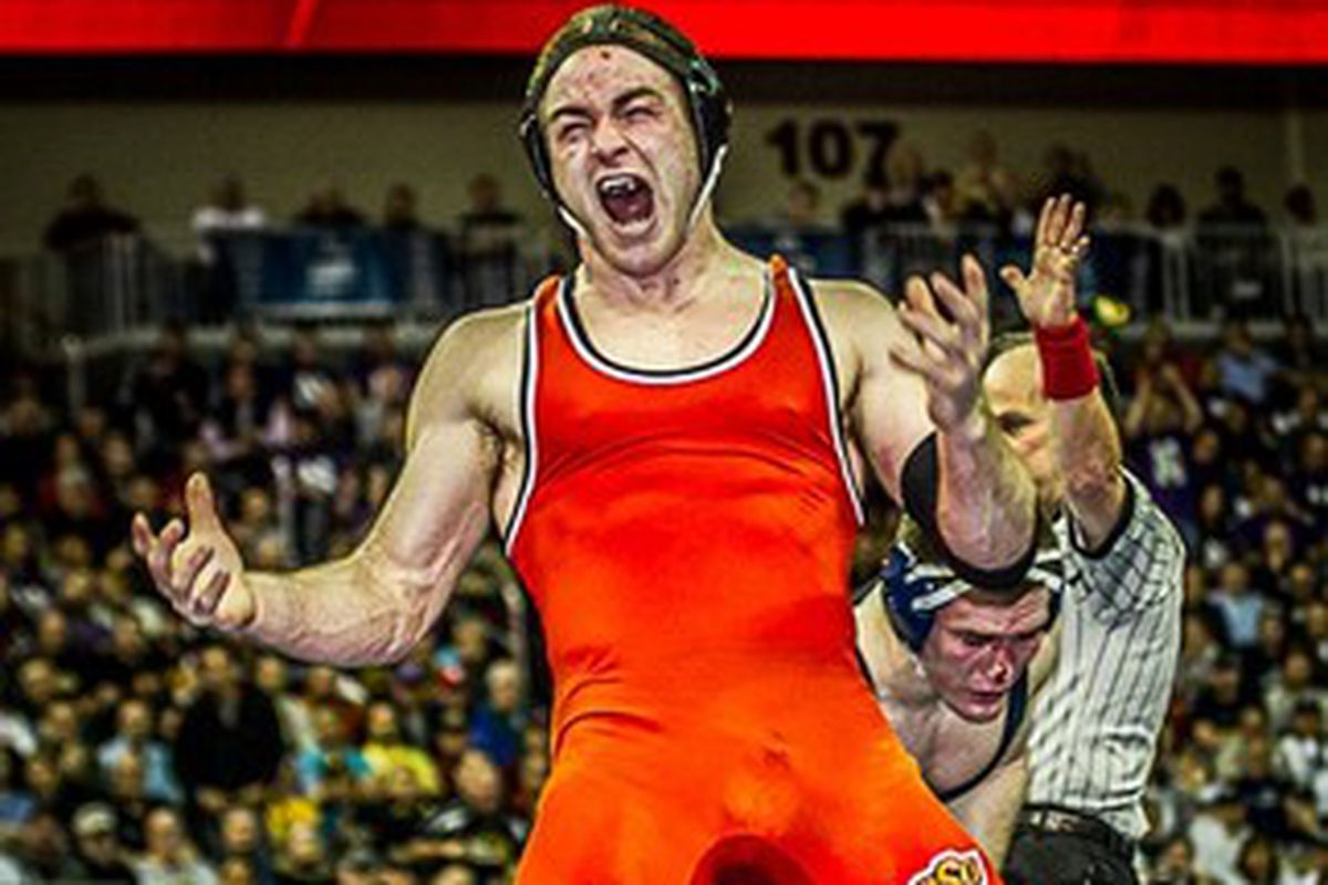 Chris Perry celebrates after winning the 2013 national championship at 174 pounds