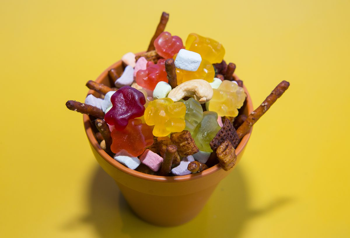 A bowl filled with various snack foods