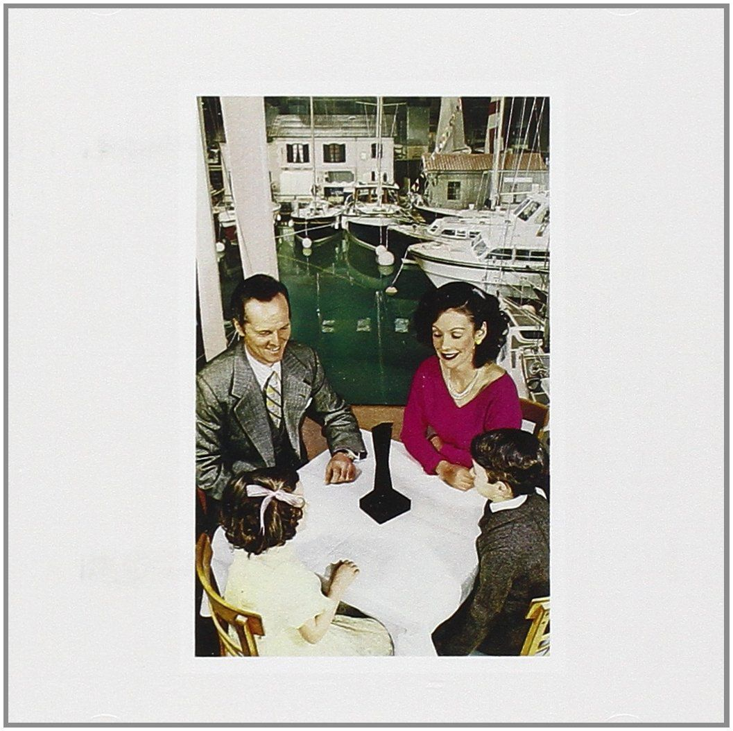 """Amazon Echo reminds me of the eerie album cover photo for Led Zeppelin's """"Presence,"""" which shows a family smiling at a mysterious black obelisk."""