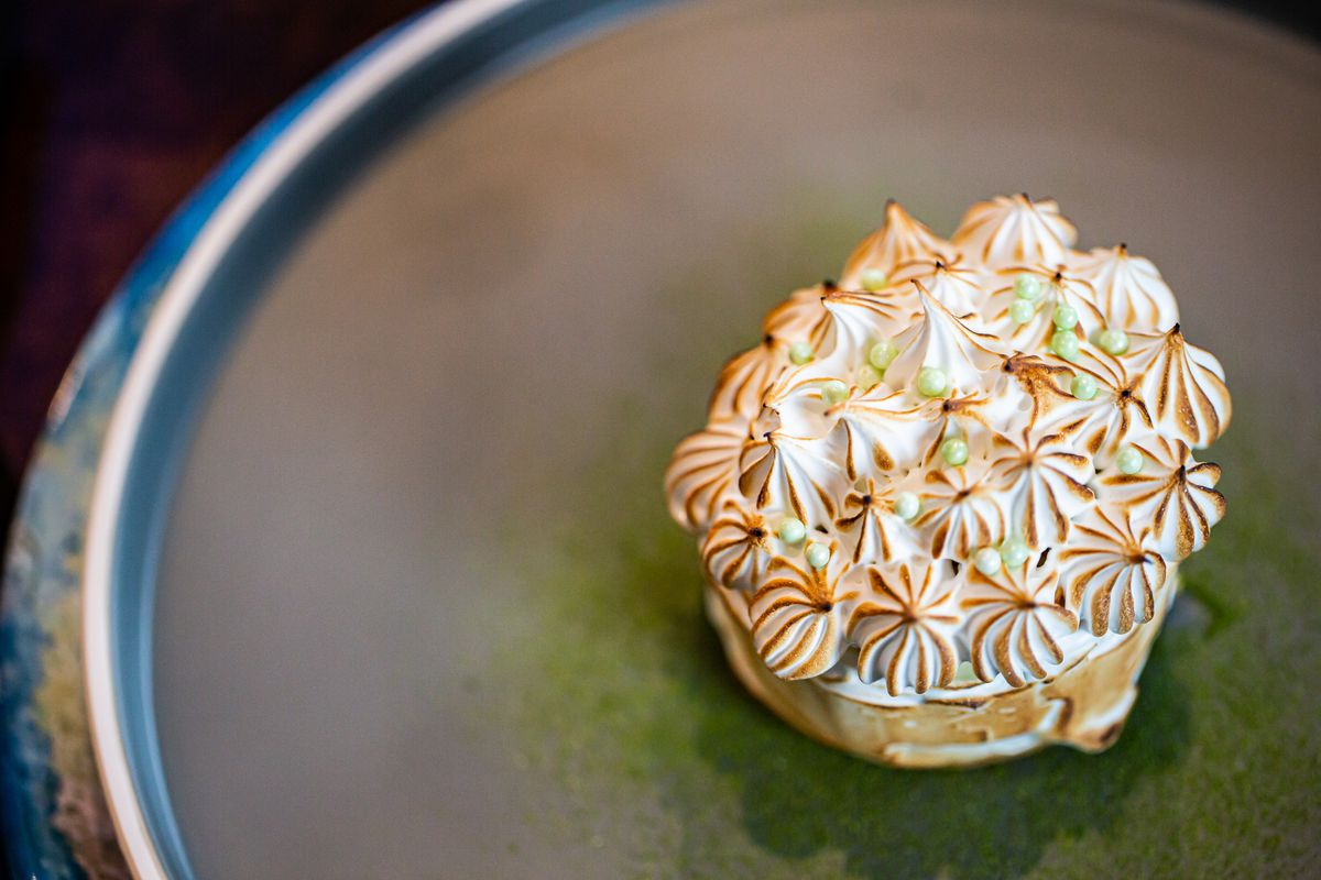 Key lime-baked Atlanta with key lime mousse, toasted meringue, and dusting of kaffir lime powder