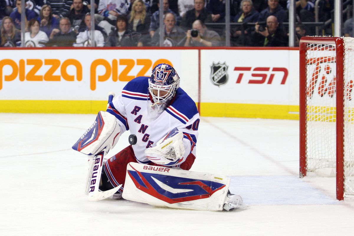 Mar 28, 2012; Winnipeg, MB, CAN; New York Rangers goalie Henrik Lundqvist (30) makes a save during the second period against the Winnipeg Jets at the MTS Centre. Mandatory Credit: Bruce Fedyck-US PRESSWIRE