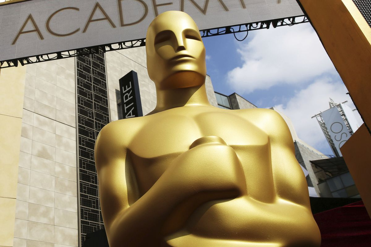 In this Feb. 21, 2015 file photo, an Oscar statue appears outside the Dolby Theatre for the 87th Academy Awards in Los Angeles. Some people watch awards shows out of love, others because they love to hate. But this year, as ratings have taken a dive, will anybody tune in to the Oscars?
