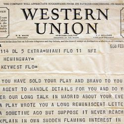 This Sept. 11, 2012, photo shows a telegram sent to Ernest Hemingway from American theater producer Jean Dalrymple in 1938, a part of the Hemingway collection at the John F. Kennedy Library and Museum in Boston, which is being sent out for restoration. Among letters written to Ernest Hemingway slated for repair are dispatches from public figures including Hollywood stars Ingrid Bergman and Marlene Dietrich, writers F. Scott Fitzgerald and Gertrude Stein, and Hemingway's editor Max Perkins.