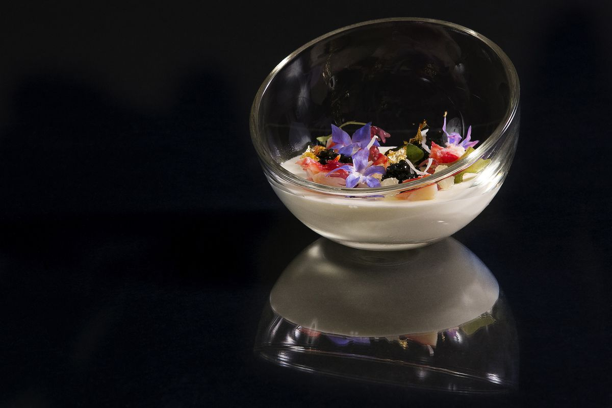 A glass bowl filled with colorful gastronomic delights.